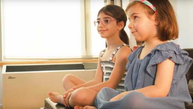 two girls using alexa