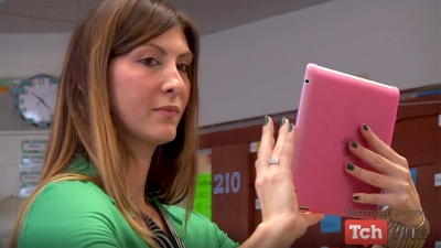 Woman holding pink tablet