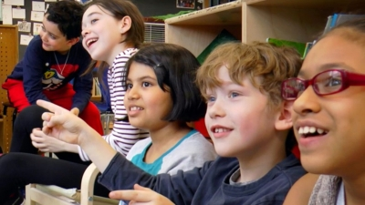 Video thumbnail image of children of various races smiling in a classroom setting
