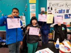 Kids holding paper